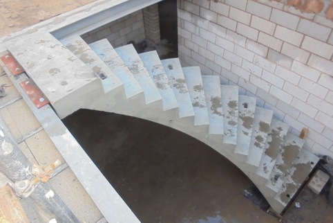 curved precast concrete stair installed to steel frame