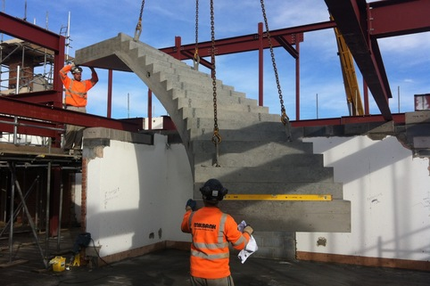 precast concrete curved stair installed with crane