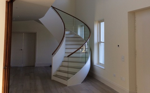 Kallisto curved stair finished with glass balustrade