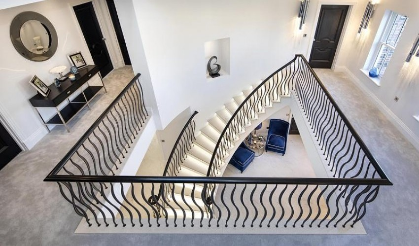 Luxury Curved Staircase - Aerial Landing View