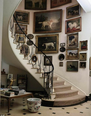 pictures hanging around curved staircase
