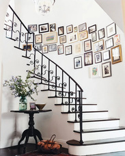 Hanging pictures around spiral stairs