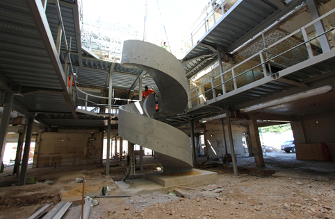 two precast concrete luxury spiral curved helical stairs staircase craned into position