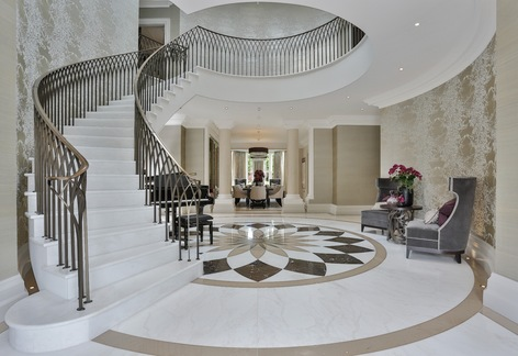 A luxury curved stair design into an open landing
